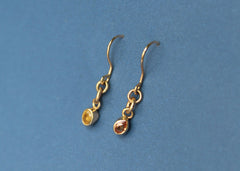 Refract Earrings in 10k yellow gold with orange and yellow sapphires
