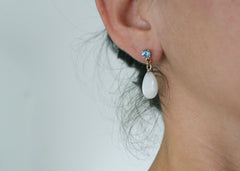 Refract Earrings in 14k yellow gold moonstone drops with garnet and blue topaz studs