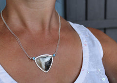 Shield Necklace with blue topaz and hand-cut cabochon