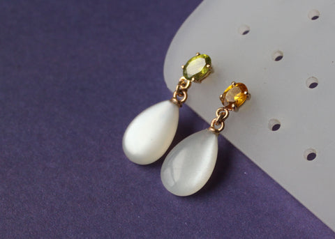Refract Earrings in 14k yellow gold moonstone drops with yellow topaz and peridot studs
