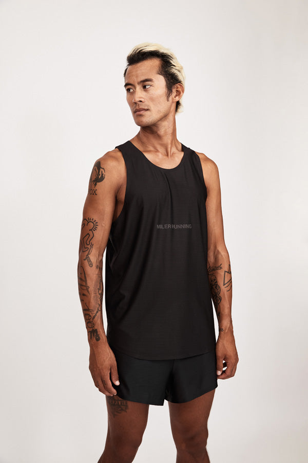 Model with running singlet and shorts turned