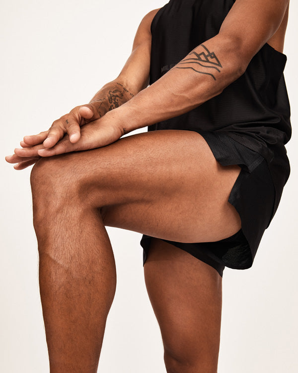 Model with running shorts stretching showing 3 inch split
