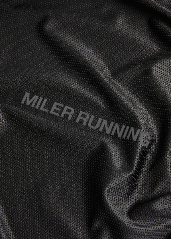 Running singlet fabric close up with reflective logo