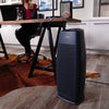 Hunter HP600 Tall Tower Air Purifier, Black, Sitting in Work Office