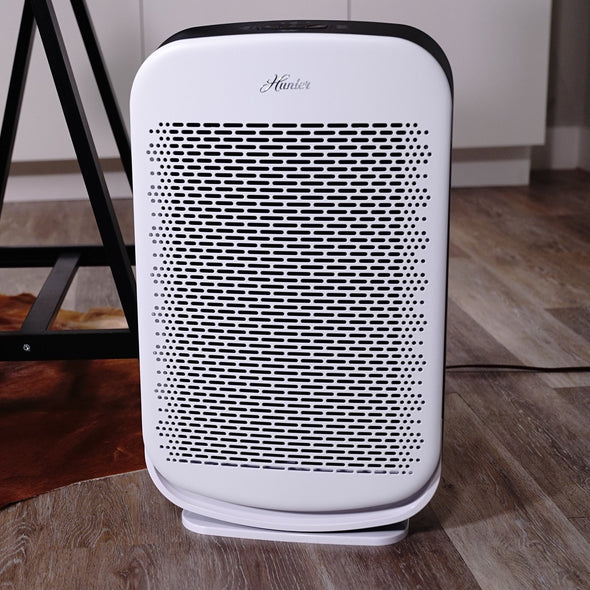 Hunter HP700 Medium Console Air Purifier, White, Sitting in Living Room