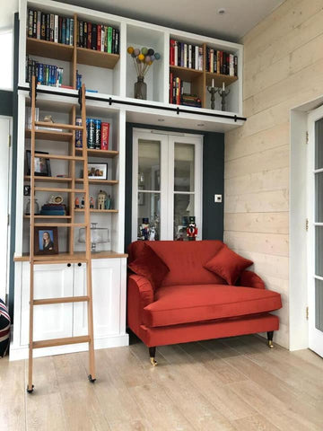 Shelving unit and library ladder designed by Flint Barn Joinery