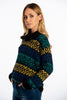Infinity Knitwear turtle neck jumper with fairsile print