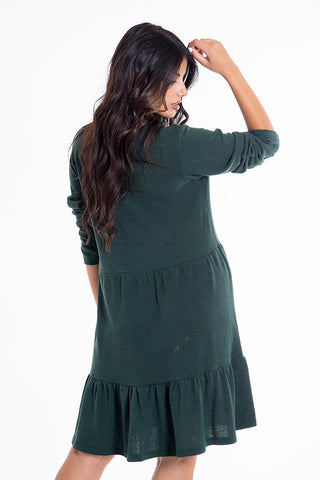 Knitted long sleeved dress in frills