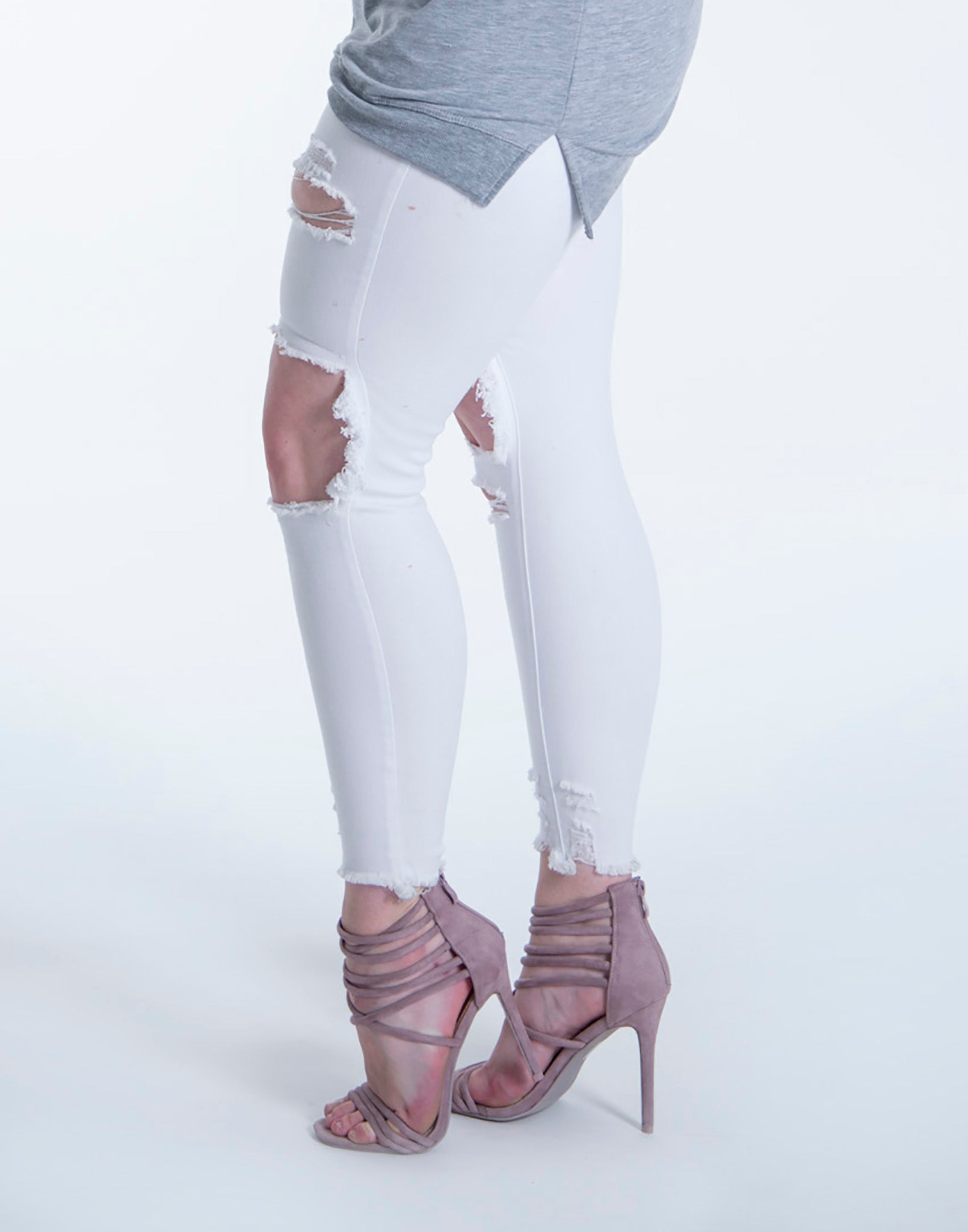 Skinny ripped white jeans