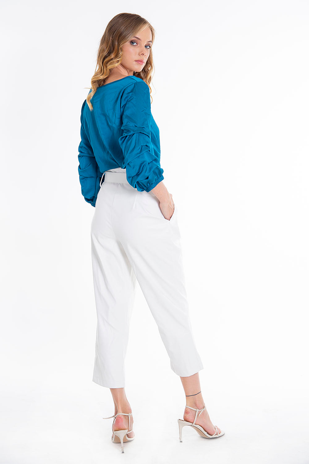 Akè high waisted belted faux leather trousers