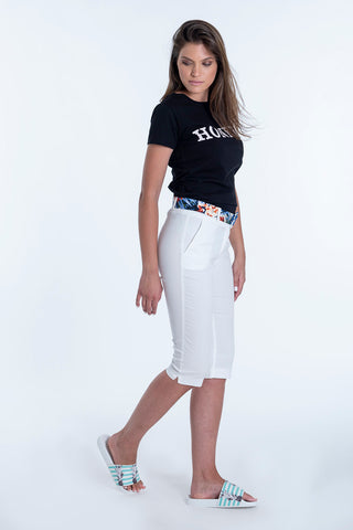 Akè knee length tailored trousers with floral belt
