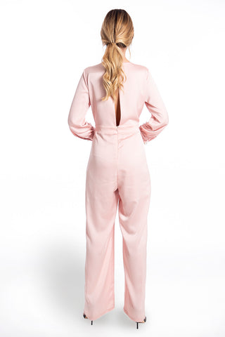 Akè long sleeved jumpsuit with wrap front and pearl button details