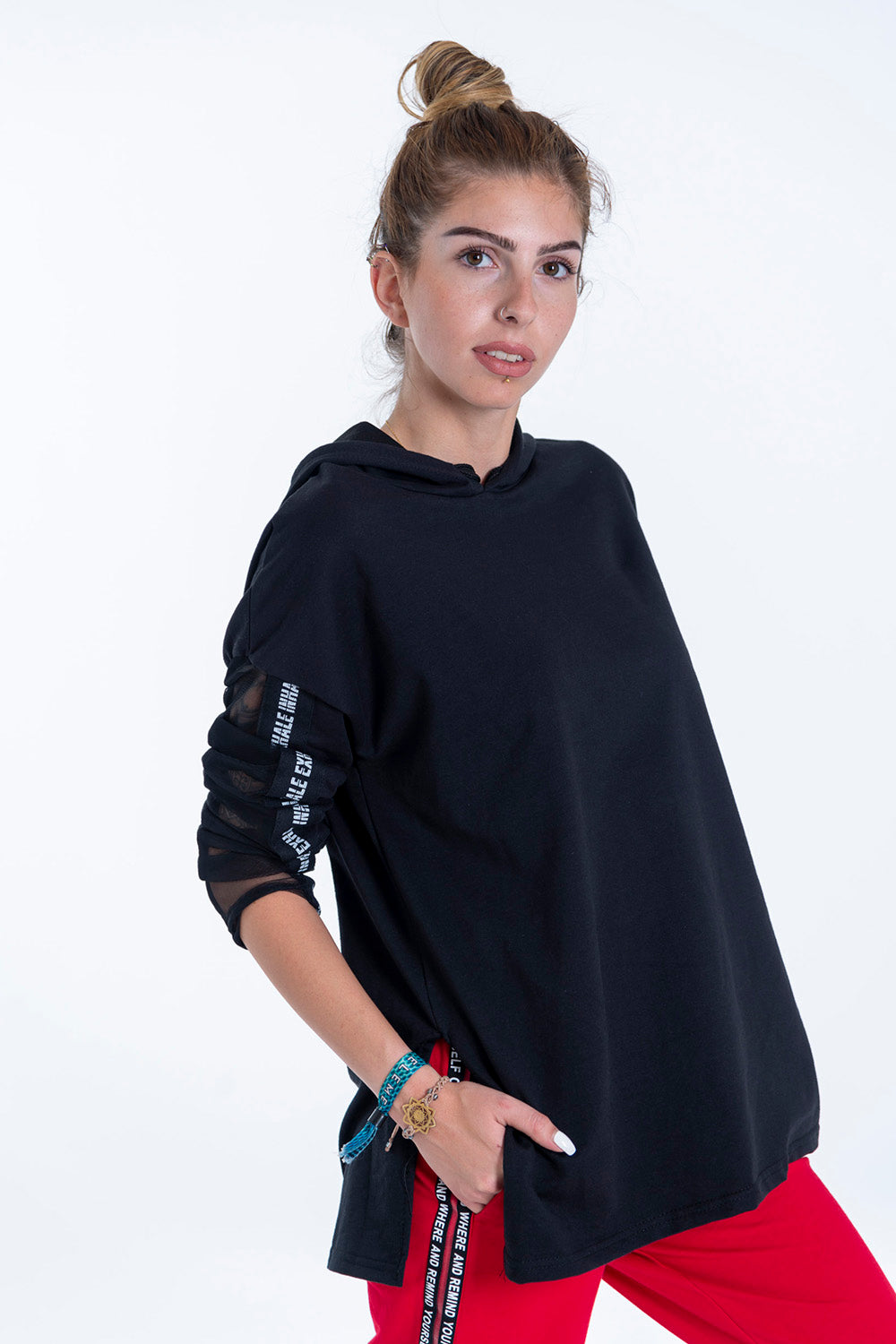 Jumper with hood and see through sleeve detail and text