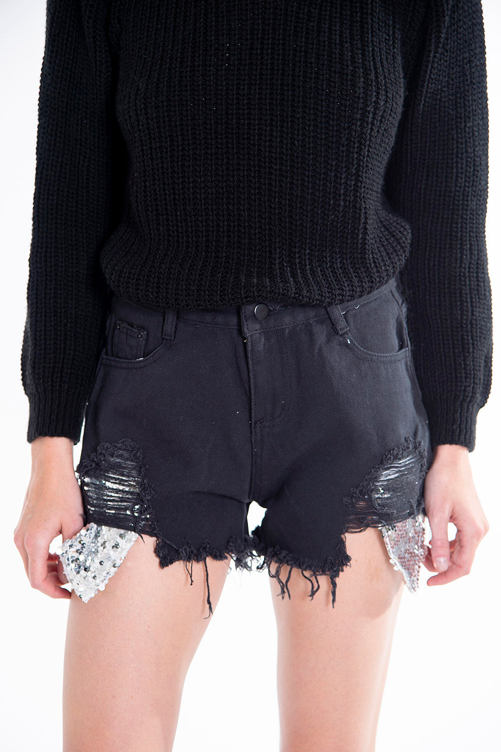 Oversized ripped shorts with sequin pockets
