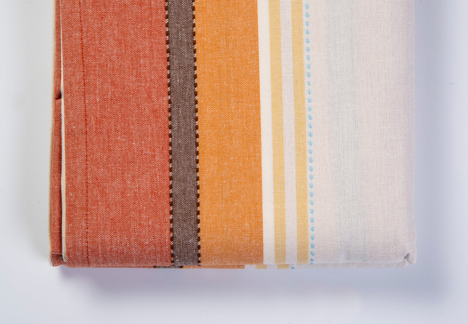 Warm colours oblong table cloth with sewing details