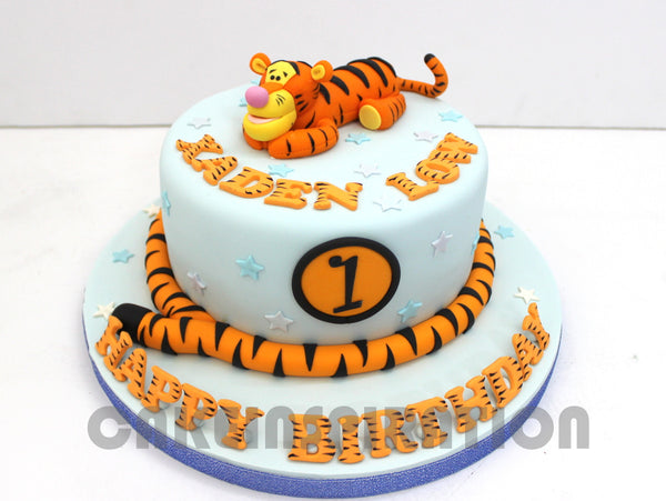 CUSTOMIZED CHILDREN  COLLECTION / tiger theme 1st year cake w long tail / pastel blue cake