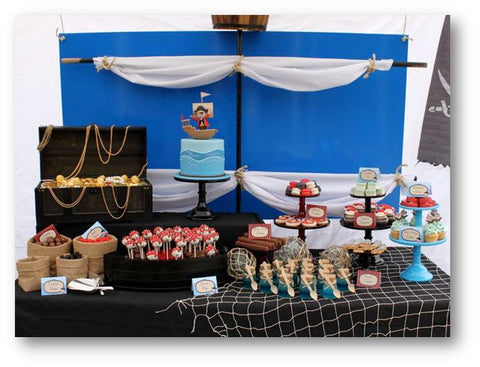 dessert table COLLECTION / PIRATE THEME PROPOSAL / BIRTHDAY CELEBRATIONS WITH A PIRATE THEME SET UP