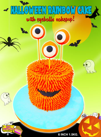 Halloween theme orange furry monster with cake pop eye balls
