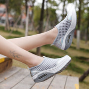 white slip on sneakers womens