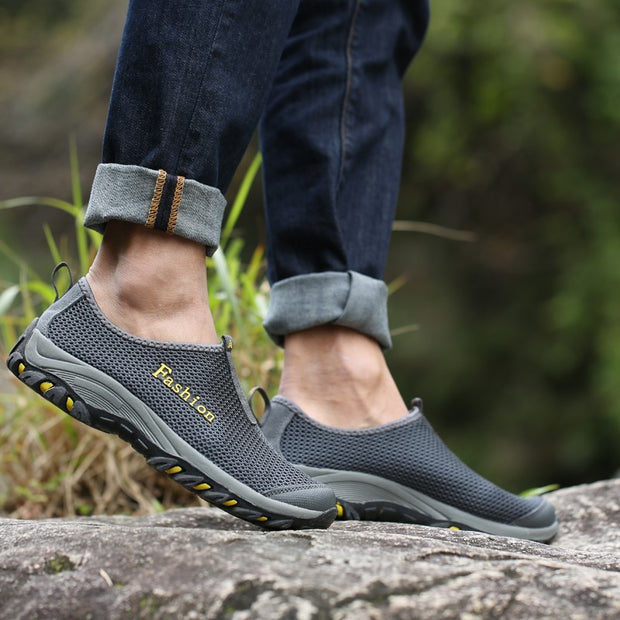 Man's sporty outdoor slip-on flat hiking tennis sneakers