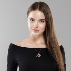 woman wearing gold panther pendant necklace