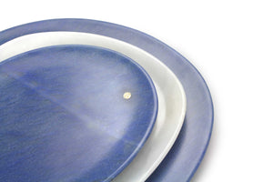 Set of presentation plates in mixed marbles