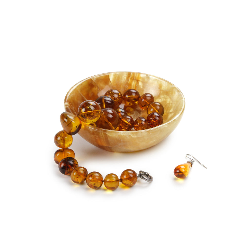 Small circular bowl in amber onyx