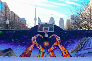 Hoop in Toronto Canada with a View of Skyline in the Winter