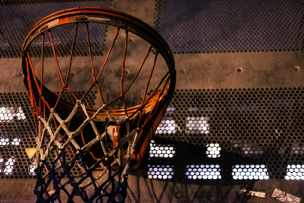 New York City Hoop at Night With an NBA Logo On the Mesh