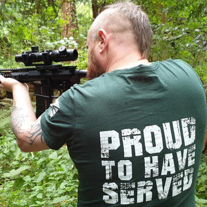 JP wearing the proud to have served tshirt while firing an AR15 in the forest
