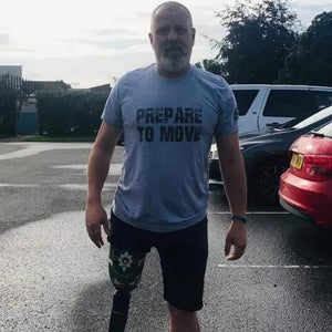 Prepare to move tshirt worn by brian chapman who is a below the knee amputee