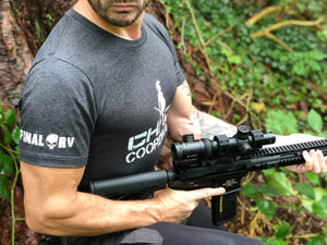 Craig Dean wearing the Chaos Coordinator Tshirt while carrying an AR15 rifle
