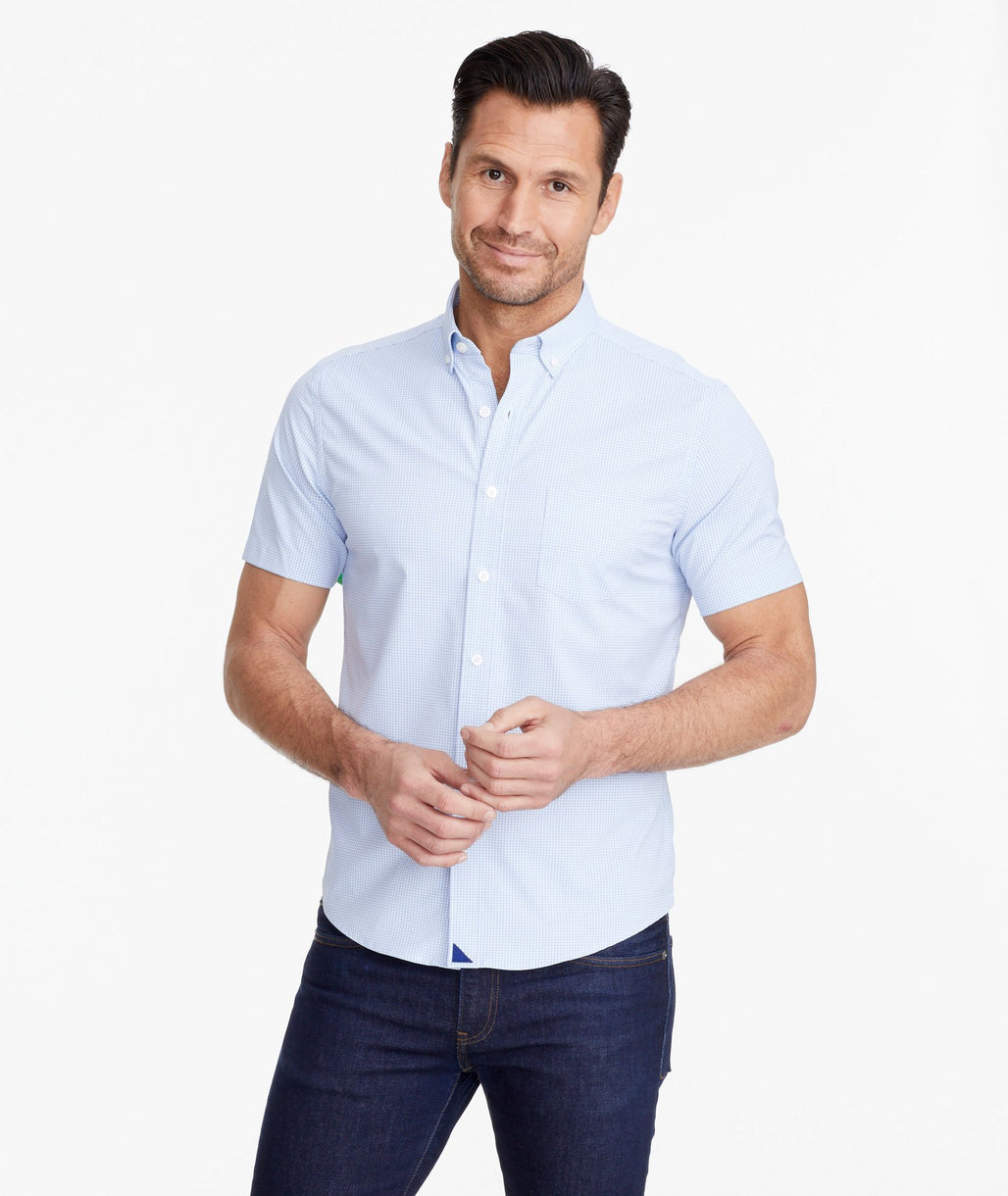 A model wearing a Light Blue Wrinkle-Free Performance+ Short-Sleeve Arcole Shirt