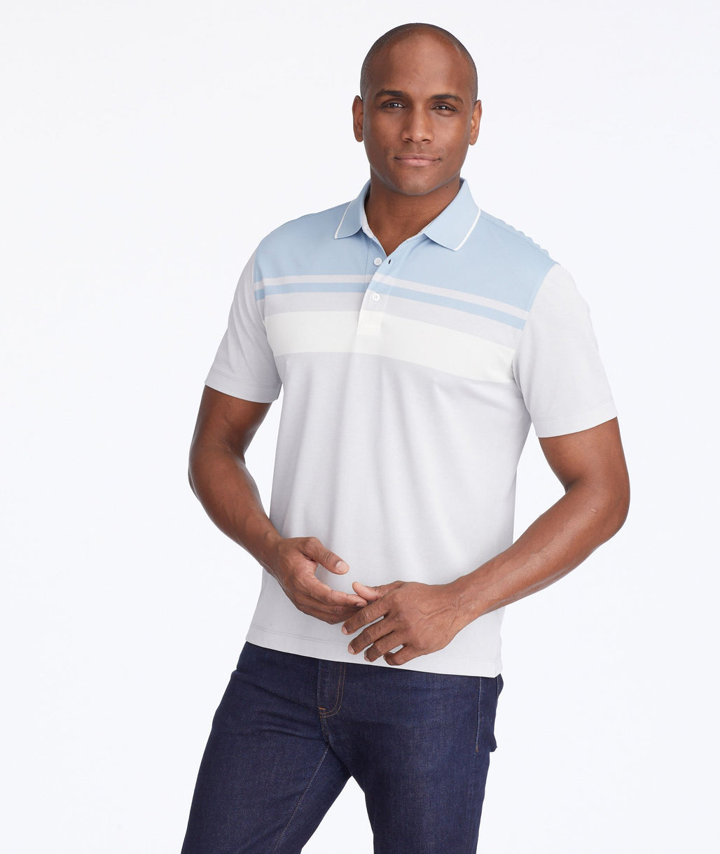 Model wearing a Grey Pique Traveler Polo