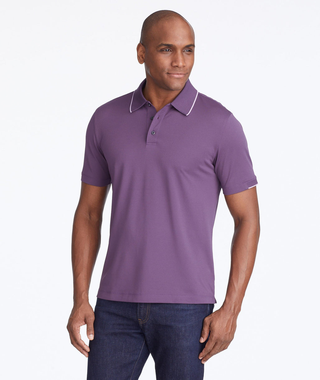 Model wearing a Purple Tipped Traveler Polo with COOLMAX®
