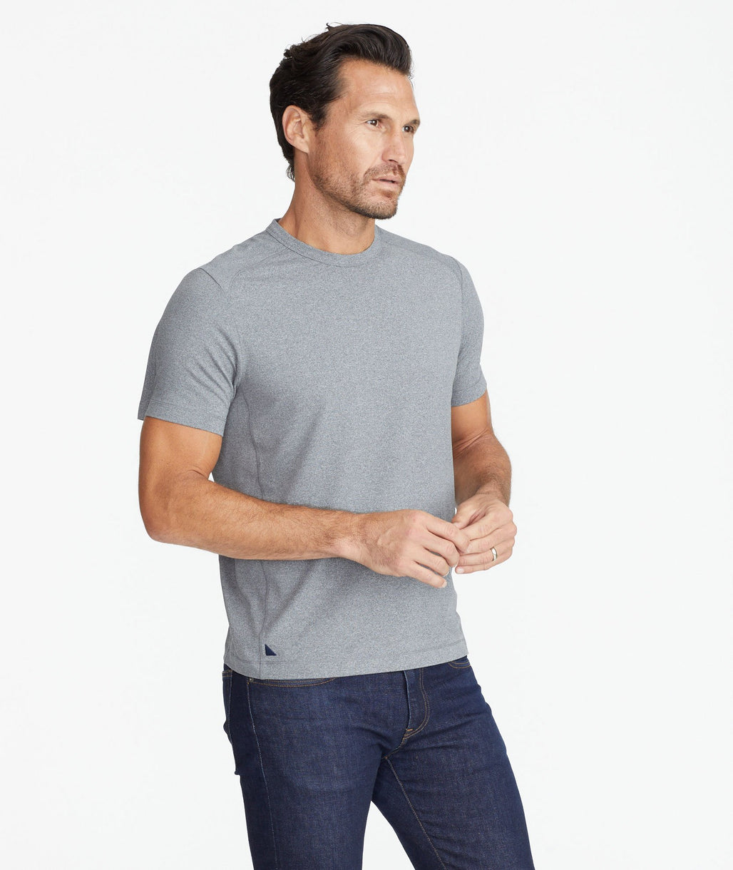 Model wearing a Grey Performance Tee
