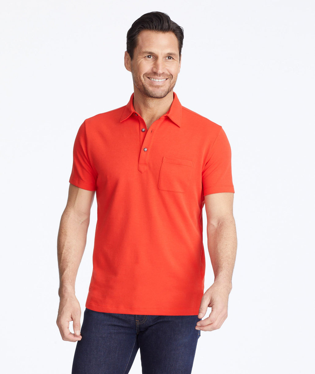 Model wearing a Red Traveler Polo with COOLMAX®