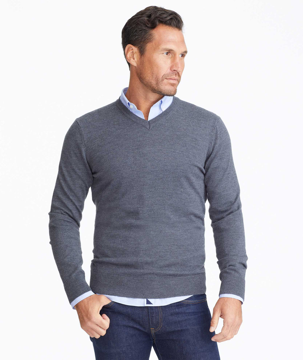 Model wearing a Dark Grey Merino Wool V-Neck Sweater