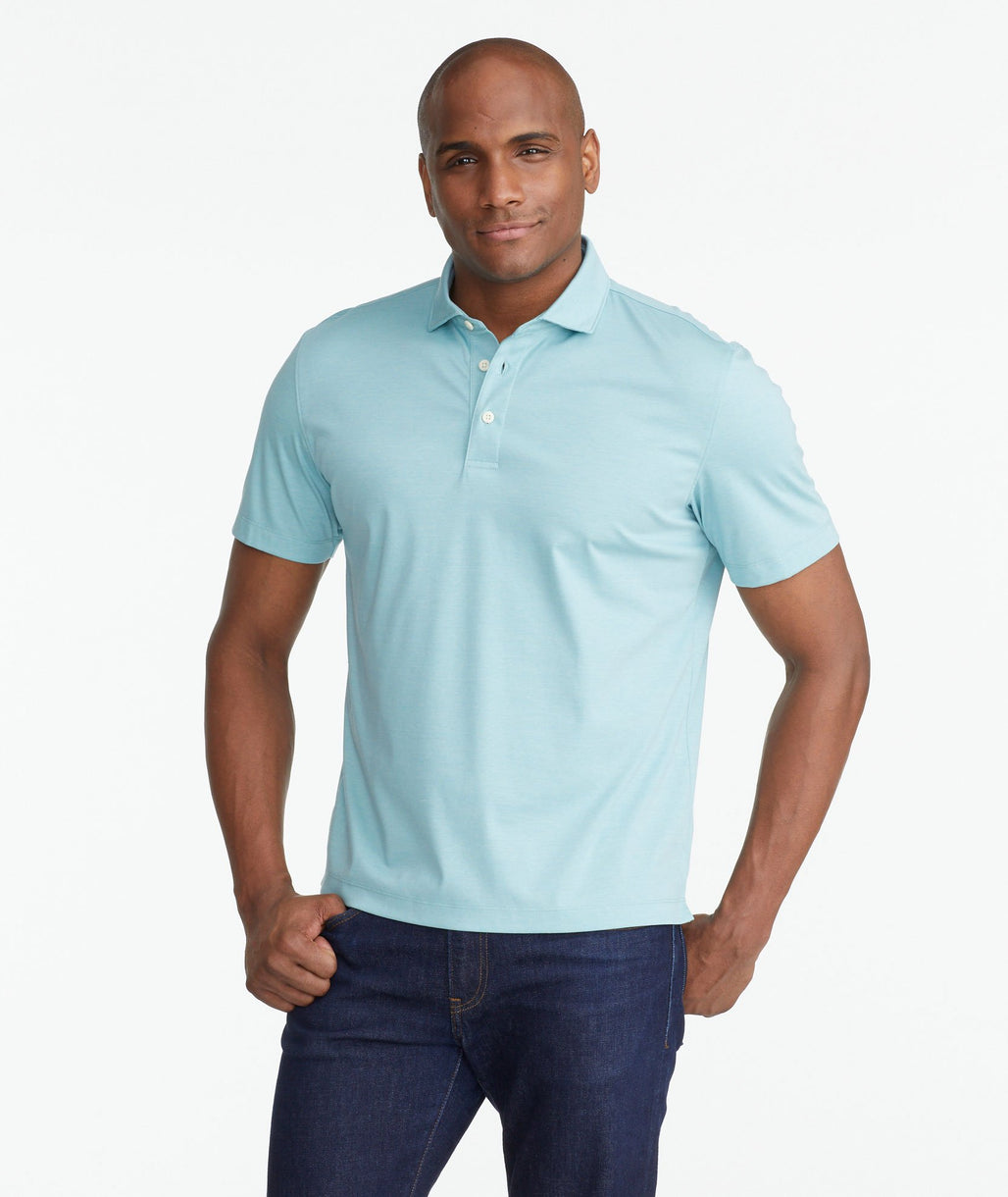 A model wearing a Green Luxe Wrinkle-Free Pique Polo