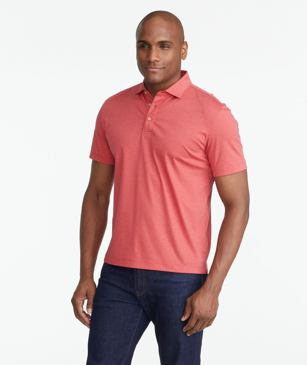 A model wearing a Red Luxe Wrinkle-Free Pique Polo