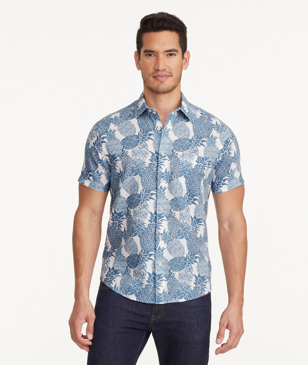 A model wearing a Blue Cotton-Linen Short-Sleeve Yoti Shirt