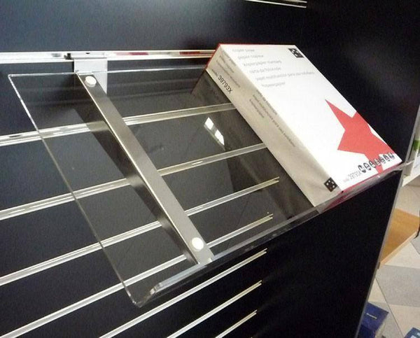 Sloping Acrylic shelves on metal brackets