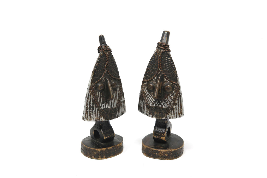 Pair of Wood and Aluminium Tribal Faced Ornaments