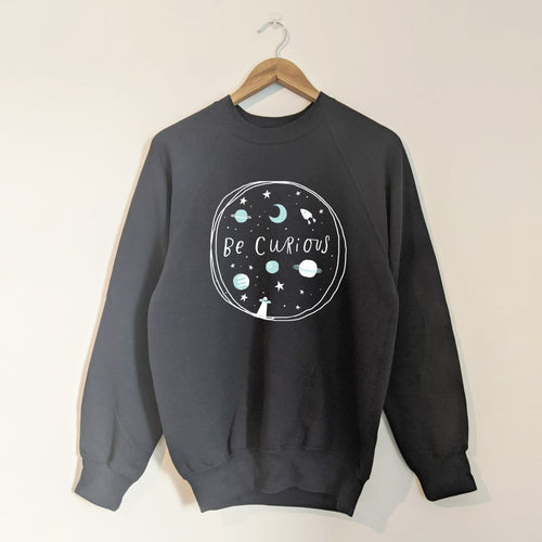 BE CURIOUS, SPACE ADVENTURER ADULT SWEATSHIRT IN NAVY