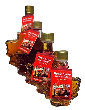 maple syrup in leaf shaped glass bottle
