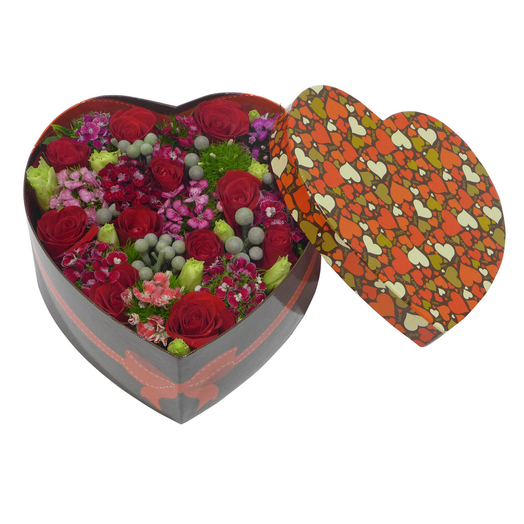 Red Roses with Matching Greens in a Heart-shaped Box