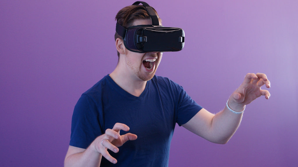 Image of young man using VR headset