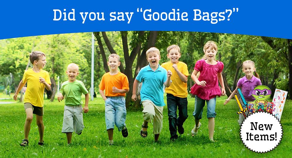 "Did you say ""Goodie Bags?"" Children are running towards the camera with excitement."