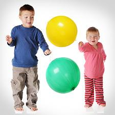 Two children playing with punchballs.
