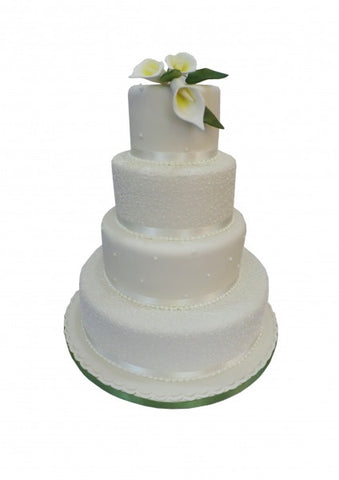 Four tiered wedding cake with ivory lilies